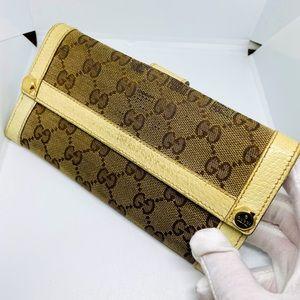 Gucci Monogram clasp wallet